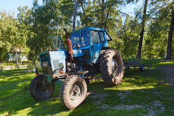 Old tractor in willage