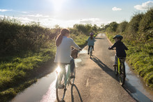 A Family Bike Ride With Mother And Two Children In The Countryside.