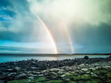 Fototapeta Rainbow - Rainbow above the famous Dinosaur bay at Staffin on the isle of Skye