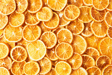 Natural Dried Oranges Or Dried Grapefruit Background. Sliced And Dried Candied Citrus Fruit Background. Food Background. Top View With Copy Space For Text. Flat Lay.