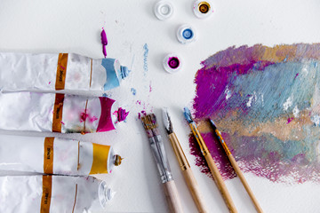 Artistic palette with paint brushes and oil paint