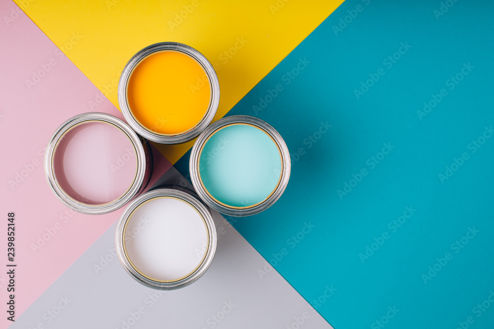 Fototapety, obrazy: Four open cans of paint on bright symmetry background. Yellow, white, pink, turquoise colors of paint. Place for text. Renovation concept.
