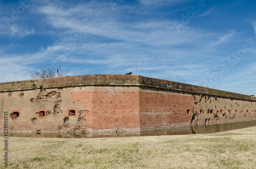 Fotografie, Obraz  Bullet holes / cannon holes in the brick walls of Fort Pulaski National Monument