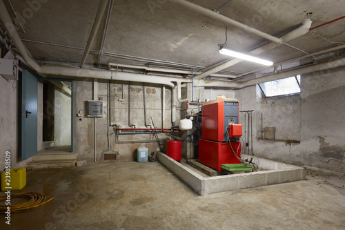 Basement with red heating boiler in old house interior Canvas Print