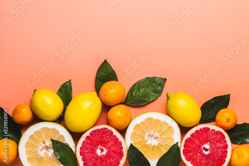 Fotobehang Keuken Living coral background with fresh citrus fruits. Healthy food concept
