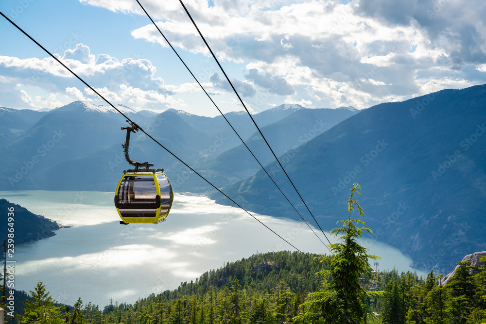 Fototapety, obrazy: View of an Empty Cable Car with a Majestic Coastal Mountains in Background on a Sunny Summer Late Afternoon
