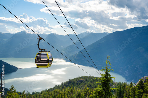 Poster Gondoles View of an Empty Cable Car with a Majestic Coastal Mountains in Background on a Sunny Summer Late Afternoon