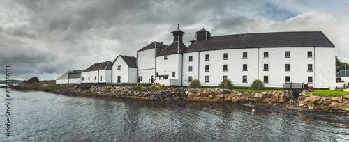 Stampa su Tela Panoramic view of Laphroaig distillery buildings