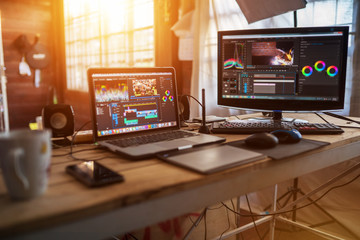 Freelance desktop with laptop computer and monitor review for editor work with content video or equipment video of vlog