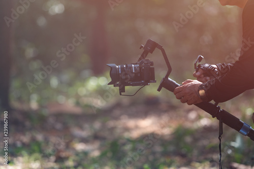 Valokuva  Professional cinematography with stabilizer gimbal shooting outdoor or Vlogger l