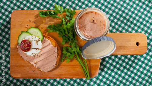 Top view of toast with pate, fresh cheese on wooden board