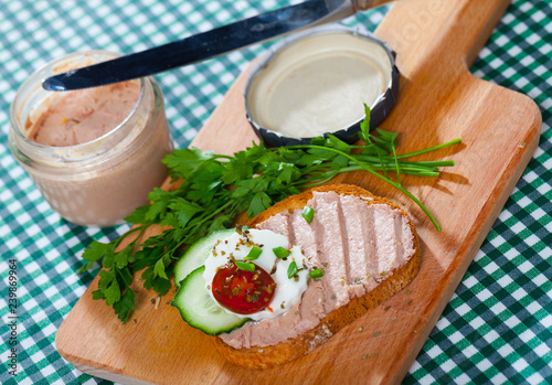 Toast with pate, fresh cheese on wooden board