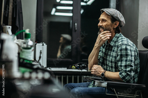 Fotografie, Obraz  Happy man smiling and touching his beautiful beard