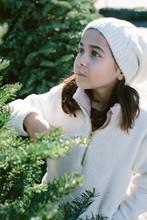 Girl Standing Near Conifer Tre...