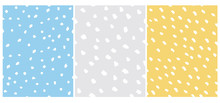Set Of 3 Cute Abstract Dots Vector Pattern. White Irregular Brush Dots On A Gray, Yellow And Blue Backgrounds. Lovely Pastel Color Delicate Layouts. Funny Infantile Style Design.