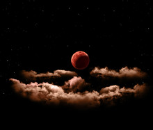Lunar Eclipse Or Blood Full Moon With Clouds
