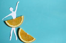 Orange Fruit Background With Ballet Dancer, Citrus Exotic Fruit, Healthy Food, Summer.