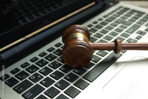 Fotografia, Obraz  Judge gavel on a computer keyboard.