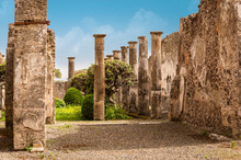 Pompeii Ruins: A Yard And Destroyed Stone Columns At Archaeological Site