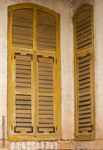 Swell Wooden Weathered Vintage Grunge Yellow Window Shutters Of Download Free Architecture Designs Embacsunscenecom