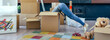 canvas print picture - Young woman inside a box while preparing the move