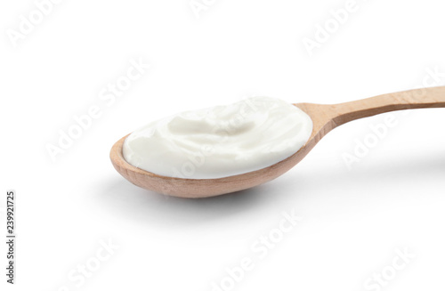 Stampa su Tela Wooden spoon with sour cream on white background