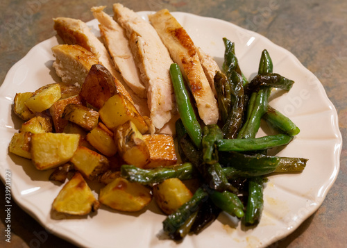 Fotografie, Obraz  Sliced boneless skinless chicken breast with roasted potatoes and green beans