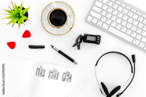 Fototapeta Desk of musician for songwriter work with hearts, coffee, keyboard, headphones and notes marble background top view obraz na płótnie