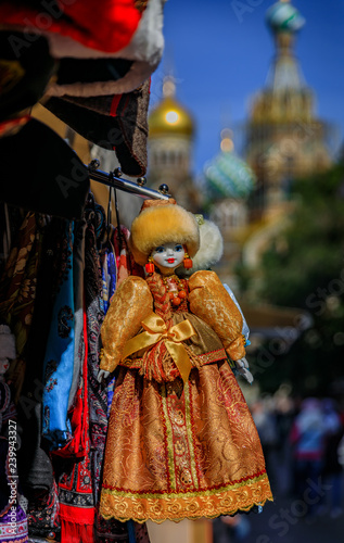 Fotografie, Obraz  Russian doll dressed in a traditional winter outfit with a fur hat in a souvenir