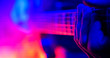canvas print picture - Rock concert. Guitarist plays on the illuminated lamps guitar. Hand close up