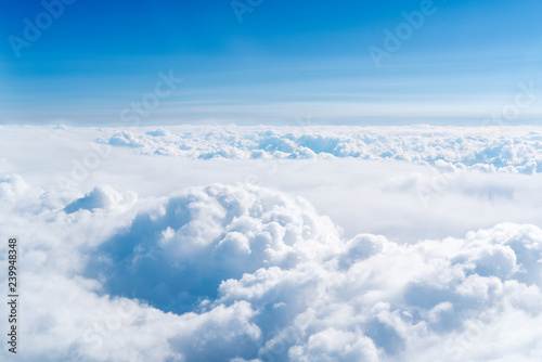 blue skyline and cloudscape, view of the airplane window - 239948348