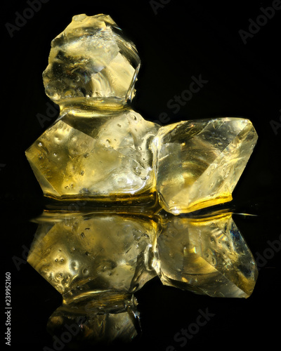 Fotografie, Obraz  Cannabis concentrate diamonds isolated on black background
