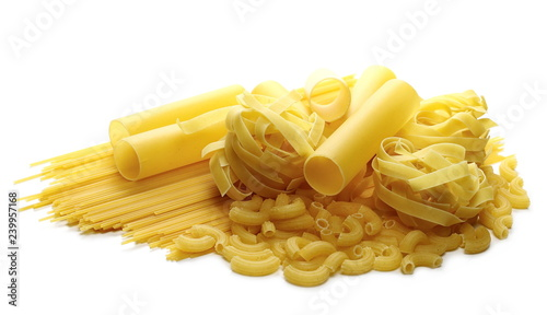 Various raw pasta types isolated on white background