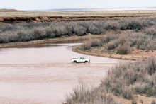 Truck Driving Through Flash Flood. Flooded Road In Arizona