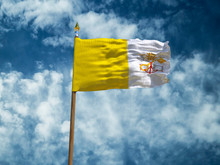 Vatican Flag Silk Waving Flag Of Vatican Made Transparent Fabric With Wooden Flagpole Gold Spear On Background Sunny Blue Sky White Smoke Clouds Real Retro Photo Countries Of World 3d Illustration