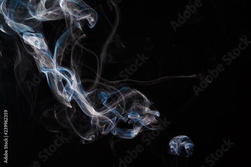 Fényképezés  Smoke fragments on a black background