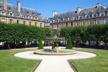 Empty Place Des Vosges In Paris In A Sunny Summer Day, Clear Blue Sky