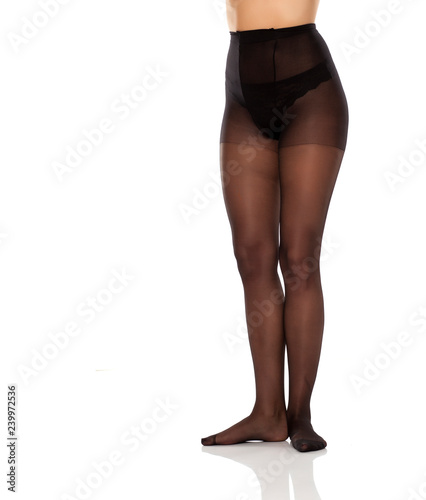 948d8e4130f pretty female long legs and black high waist nylon stockings on white  background
