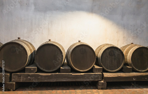 Wooden wine barrels in the cellar
