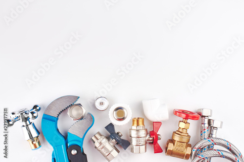 Fotografía  Plumbing parts, accessories and tools on a white background with copy space