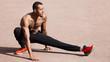 Leinwanddruck Bild - Fit shirtless black man doing stretching before workout