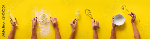 Fotografía  Female hands holding kitchen tools, sieve, rolling pin, bowl, sieve, brush, whisk, spatula for baking and cooking over yellow background