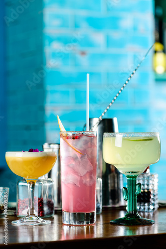 Wall Murals Photo of the day row of various colourfull alcoholic cocktails on bar counter in pup or restaurant copy space