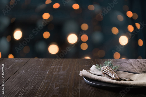 Christmas table setting and blurred kitchen as bachground. Space for montage your christmas products.