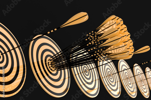 Fotografía  lot of golden arrows hit the center of the gold target on a black background