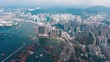 Cinematic color graded footage of aerial view West Kowloon in Hong Kong