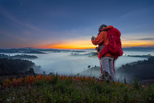 Young Female Wanderer Search Position Navigation On Mobile Phone To Find Right Way During Adventure Tour In Mountains, Woman Hiker Checks Weather Forecast Via Cell Telephone While Climbs The Mountain