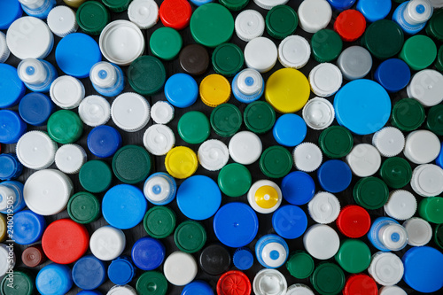 Collection of various colorful plastic screw caps #240019505