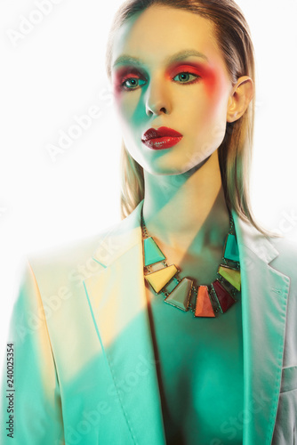 Tuinposter womenART Sexy lady in colorful neacklace and white jacket
