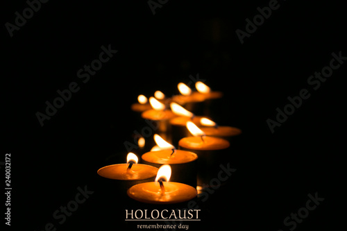Fotomural Candles in the dark. Memorial, hope, remembrance day
